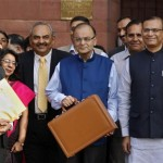 India's FM Jaitley poses as he leaves his office to present the 2015/16 federal budget in New Delhi